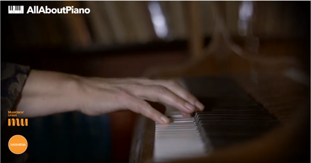 fingers on piano keyboard